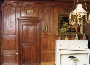 comprenant 3 portes de passage dont une vitrée, un meuble de